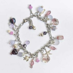Pink and white glass bead charm bracelet